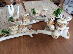 【沖縄・今帰仁村】海からの恵み貝殻やサンゴで貝殻シーサーサンゴ乗せの画像