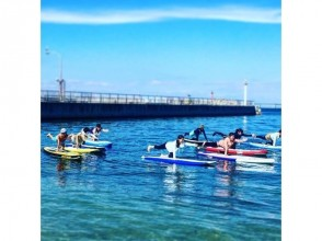 【Osaka · Kinki in front】 40 minutes from Osaka city! Relaxing on the beautiful sandy beach where you can see the airplane SUPYOGA SUP Ocean Yoga! Image of