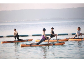 While taking a sunrise Sunrise SUP yoga experience at the beach! Image of