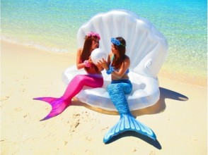 Mermaid photo shooting on the foreshore beach in Japan ♬ Seashell float service! Two mermaid suit can be worn! Image of