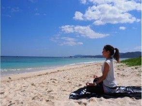 Image of beach yoga