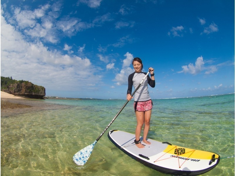 Attraction of plan First of all, lecture on how to ride SUP on land. Beginners are also safe. Image of