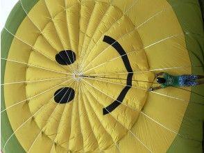 プランの魅力 パラシュートは可愛いニコちゃんマーク の画像