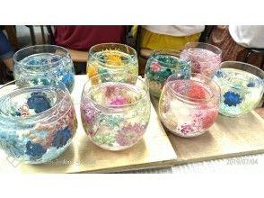 プランの魅力 A candle with transparent flowers の画像