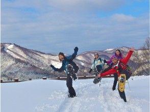 Trekking while enjoying the snow scene