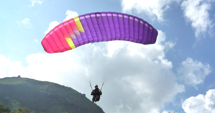 What weather conditions are necessary for paraglider experience