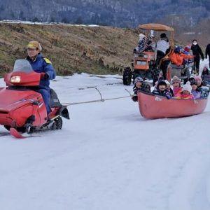 Canoe Snow Sledding